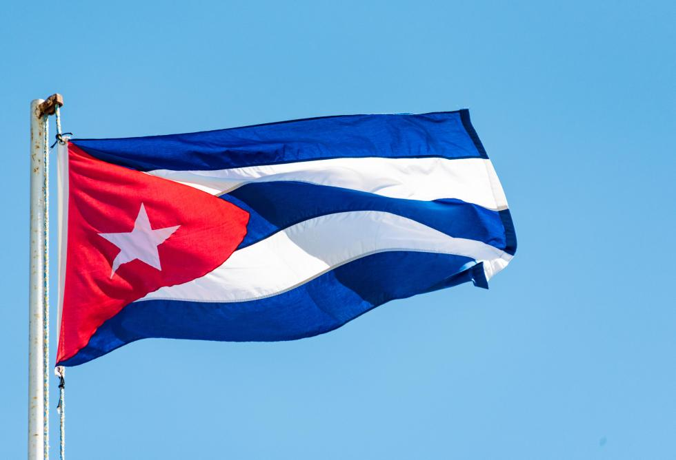 Colorful Cuban flag waiving high in the air, beautiful red,