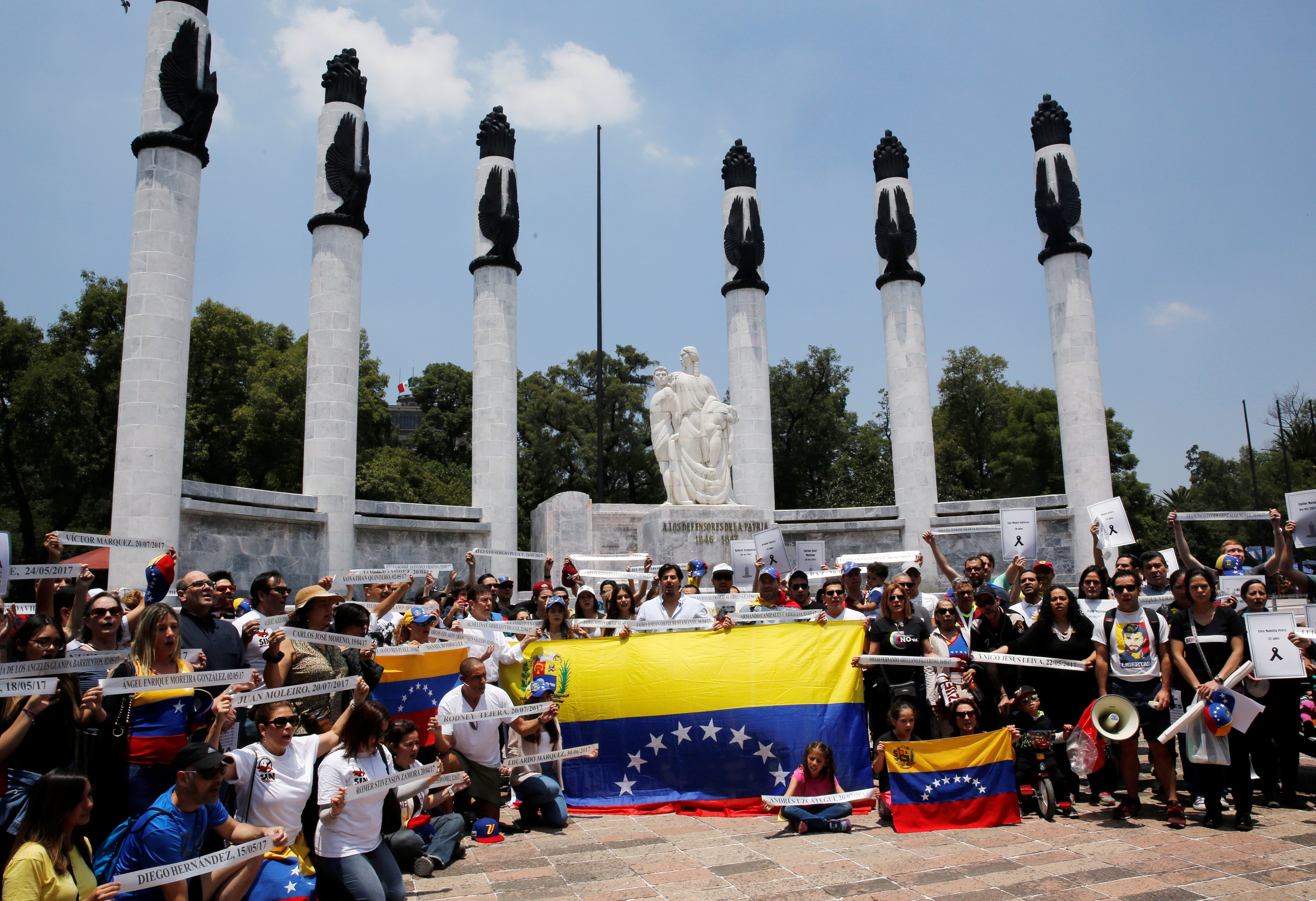People hold Venezuela flags as they take part in a protest held by Venezuelans in Mexico against Venezuela's Constituent Assembly election, at the Heroic Children monument in Mexico City, Mexico  July 30, 2017. REUTERS/Henry Romero